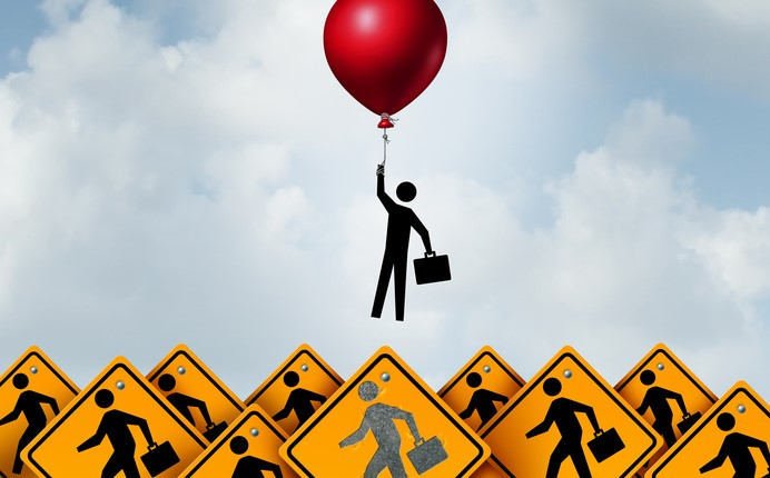Man at work being lifted up by a balloon